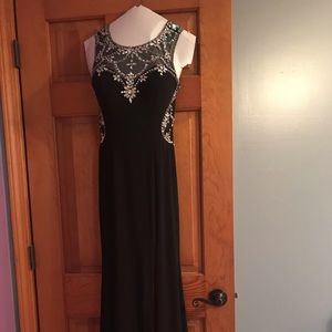 Sequined prom dress with slit on side. Worn once
